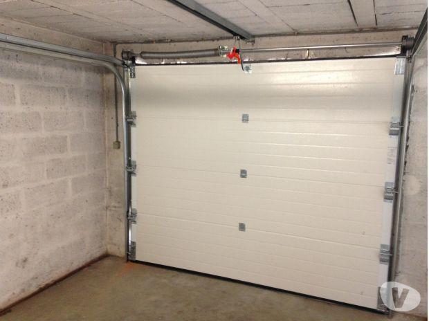 Porte de garage sectionnelle et motorisée