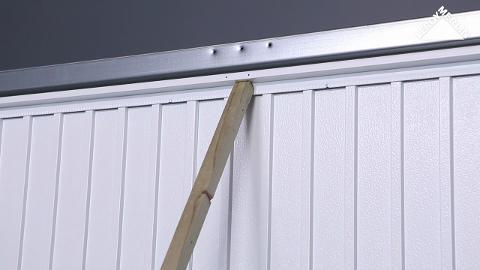 Regler une porte de garage basculante