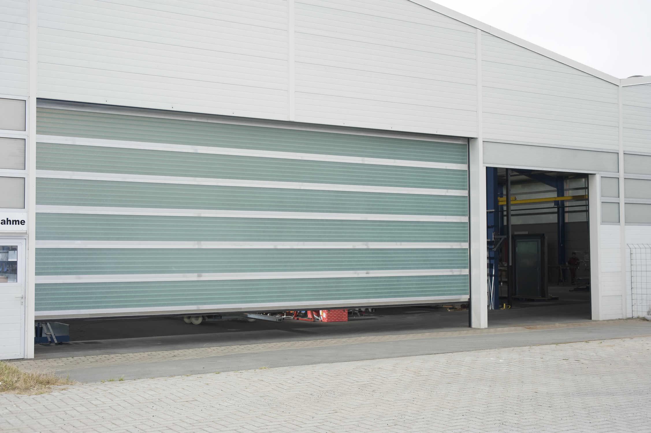 Porte de garage sectionnelle verre
