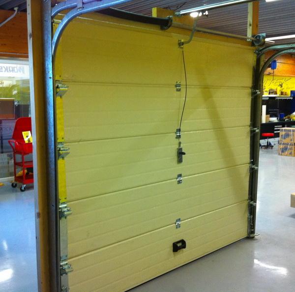 Notice de montage porte de garage sectionnelle keritek