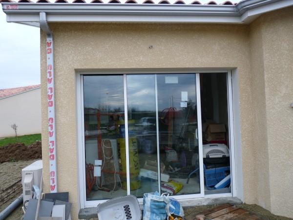 Remplacer une porte de garage par une baie coulissante