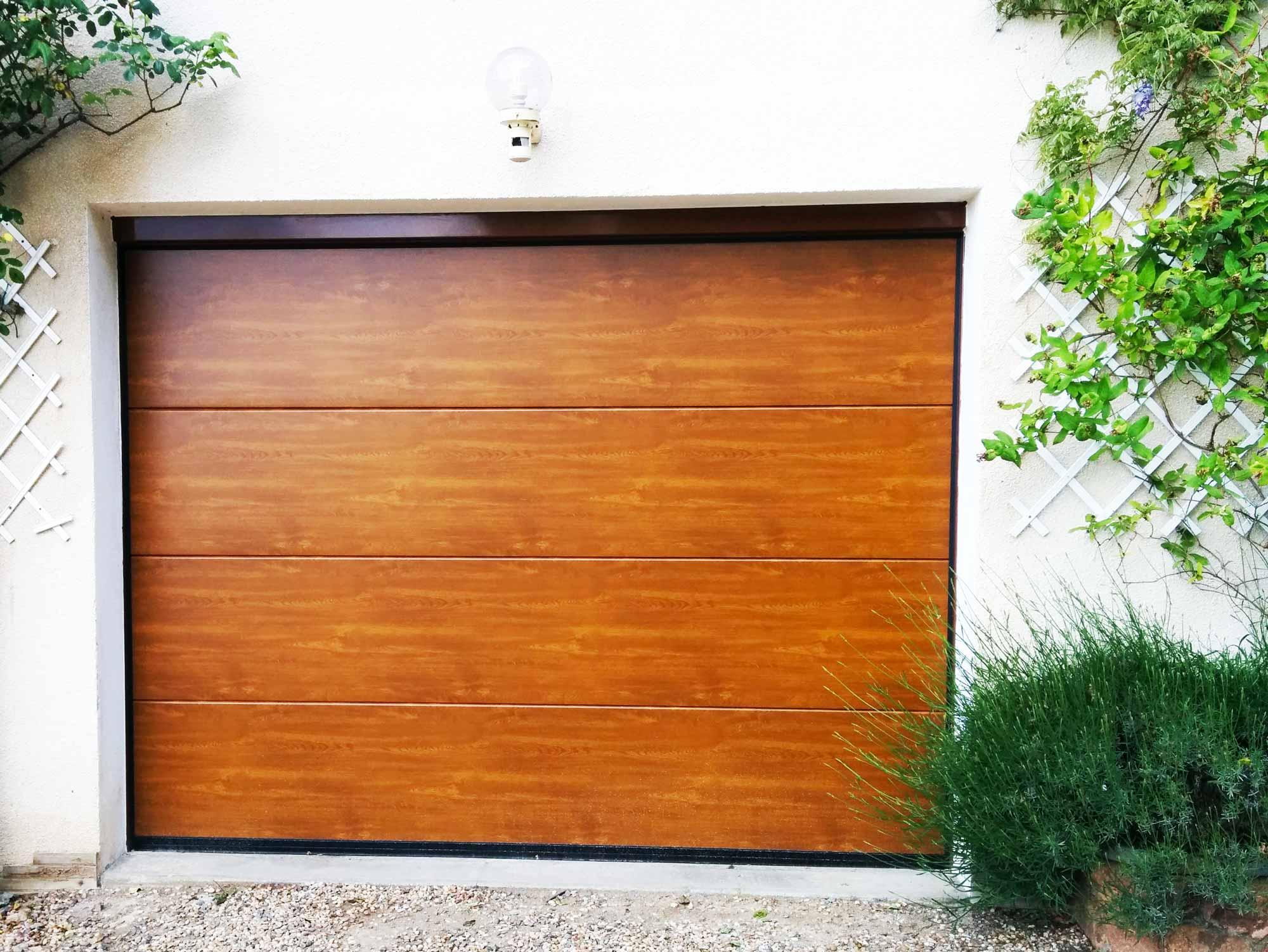 Porte de garage sectionnelle pvc chene dore