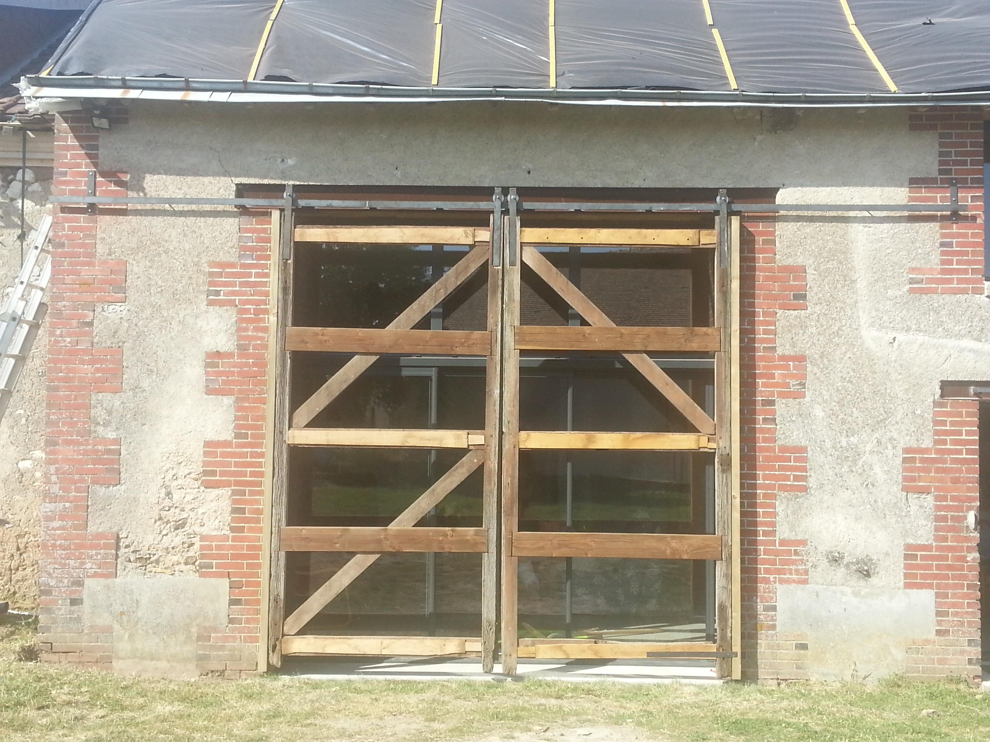 Fabriquer une porte de garage coulissante en bois