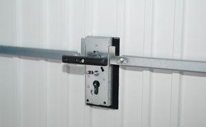 Fermeture porte de garage sectionnelle