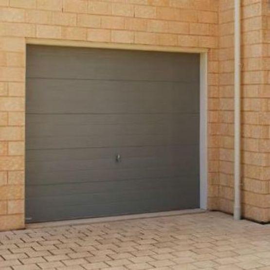 Porte de garage sectionnelle haute isolation