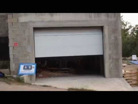 video de montage porte de garage turia bois eco. Black Bedroom Furniture Sets. Home Design Ideas