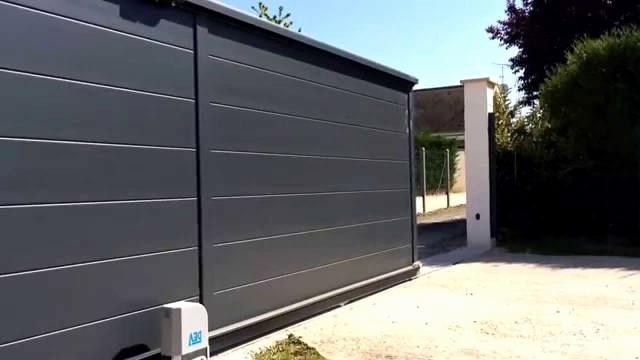 Prix porte de garage sectionnelle motoris e sur mesure bois eco - Prix porte de garage ...