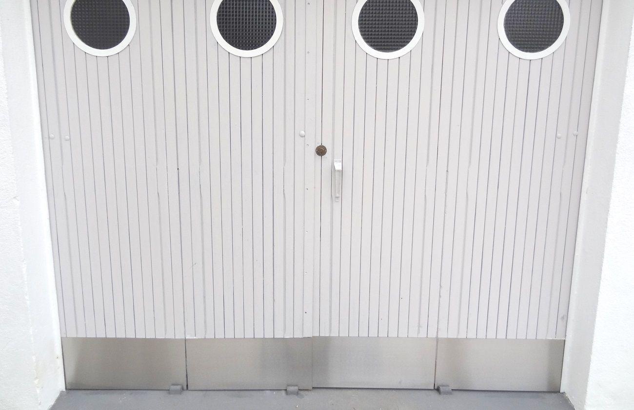 Protection bas de porte de garage